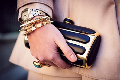 Gold bracelets worn with Cartier watch