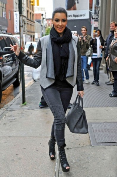 Kim Kardashian wearing black and grey