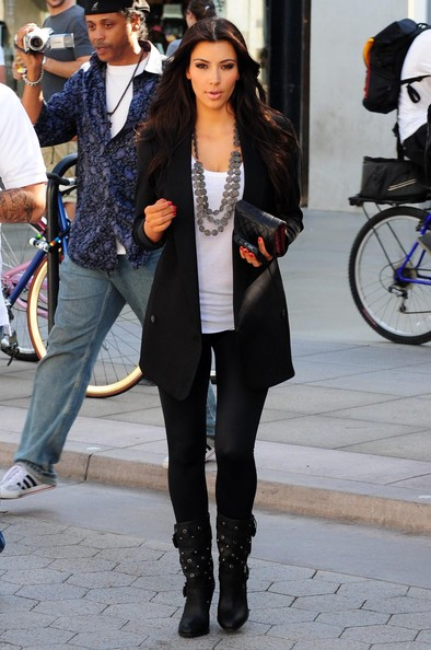Kim Kardashian dressed in leggings and longline blazer